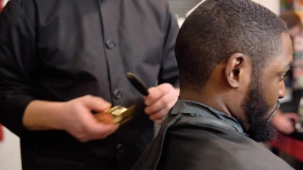 The Hairdresser Cuts the Contour of the Haircut with a Typewriter