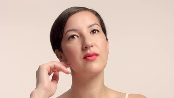 Thumbnail for Beauty Brunette Model in Studio Alone with Ideal Shiny Skin Portrait