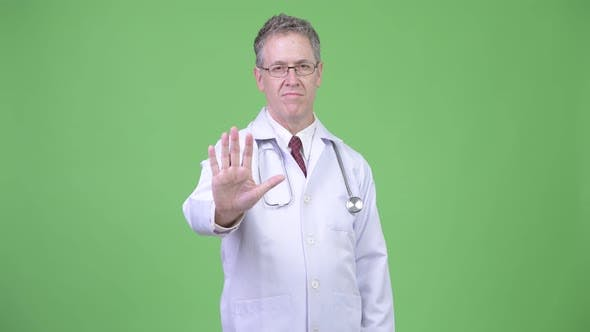 Thumbnail for Portrait of Serious Mature Man Doctor with Stop Hand Gesture