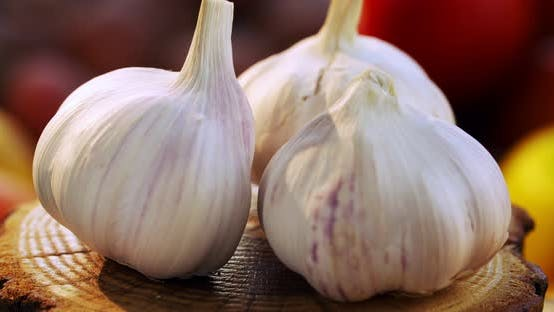 Thumbnail for Whole garlic bulbs in the peel rotate around an axis
