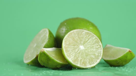 Juicy Sliced Lime Slowly Rotating.
