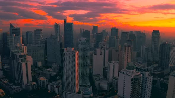 Cover Image for Beautiful Sunrise Above the High Rise Buildings in Manila City, Philippines. Aerial