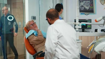 Woman with Toothache Talking with Orthodontic