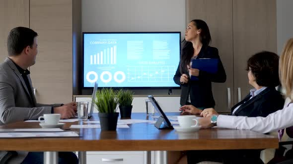 Thumbnail for Businesswoman in Meeting Room Showing Company Data