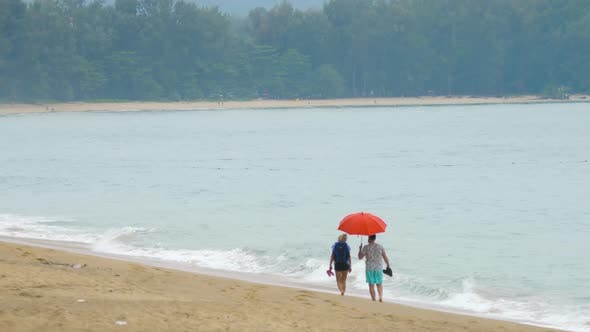 Thumbnail for Couple Walking on the Beach