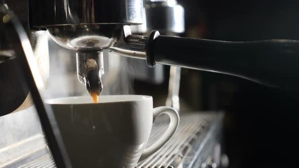Slow Motion Video. Coffee Machine Making Espresso in Cafe. Barista Making Coffee in Bar. Espresso