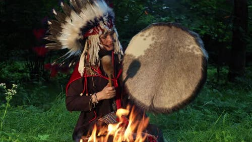 Female Shaman in Native American Indian Headdress With a Tambourine