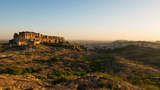 Thumbnail for Jodhpur cityscape, time lapse. The majestic fort dominating the blue city, Rajasthan, India.