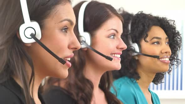 Thumbnail for Three customer service representatives talking on headsets