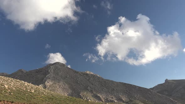 White Scattered Cloudy Sky Above Arid Mountains Without Treelees