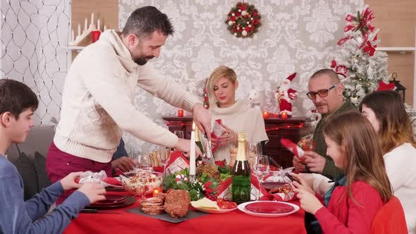 Thumbnail for Man at Christmas Dinner Slicing Delicious Turkey