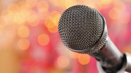 Thumbnail for Microphone on Stage Against a Blurry Light Blurry Background