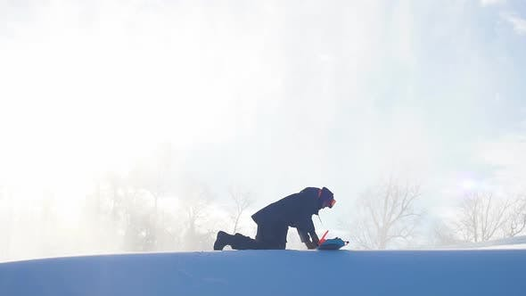 Thumbnail for Snowboarder Prepares for Freeride Session.