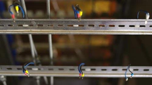 Slider Shot of a Blank Metal DIN Rails in Workshop Laboratory