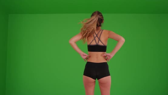 Thumbnail for Young Caucasian woman shown from behind going for run on green screen