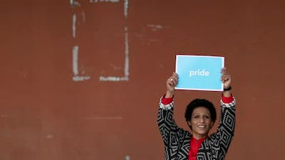 Portrait of woman holding PRIDE placard, Pistoia, Tuscany, Italy