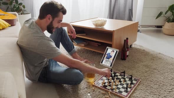 Thumbnail for Man Playing Chess With Friend