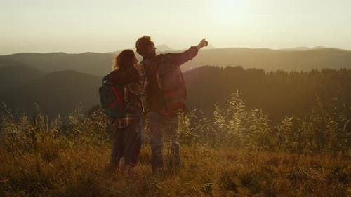 Man and Woman Having Adventure in Mountains