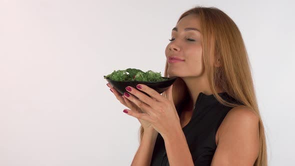 Thumbnail for Happy Healthy Woman Enjoying the Smell of Fresh Delicious Salad
