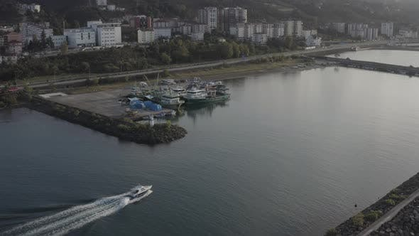 Cover Image for Trabzon City Following Boat In Canal Aerial View