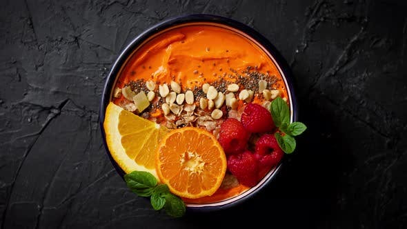 Thumbnail for Bowl with Fresh Healthy Smoothie or Yogurt. With Orange Slices, Tangerine, Raspberry, Chia and Nuts