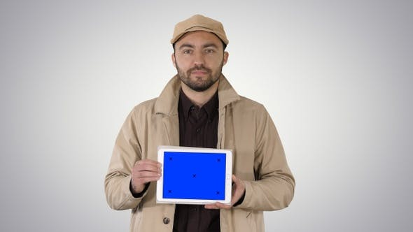 Thumbnail for Man walking and holding tablet with blue screen mockup