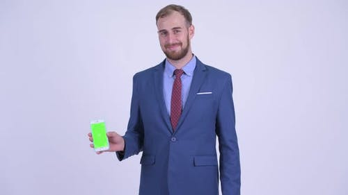 Happy Bearded Businessman Showing Phone and Giving Thumbs Up