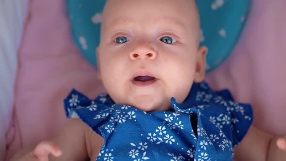 Thumbnail for Baby Girl Lying in Pram and Yawning