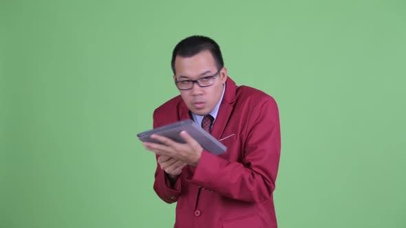 Happy Asian Businessman Using Digital Tablet and Watching Adult Videos