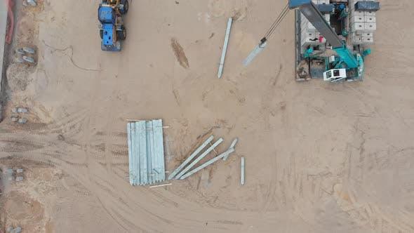 Thumbnail for Lifting Crane on the Construction Site Lifts Oblong Concrete Blocks