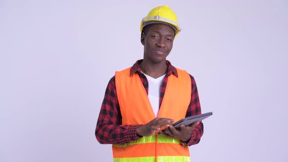 Thumbnail for Young Happy African Man Construction Worker Using Digital Tablet