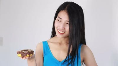 fitness woman with donut