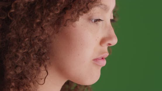Thumbnail for Black girl poses for a portrait on green screen
