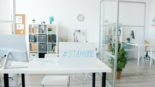Contemporary Office with No People and Stayhome Banner Because of Covid-19 Epidemic