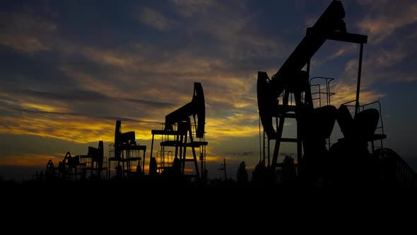 Oil Pumps Silhouette and Timelapse Sunset