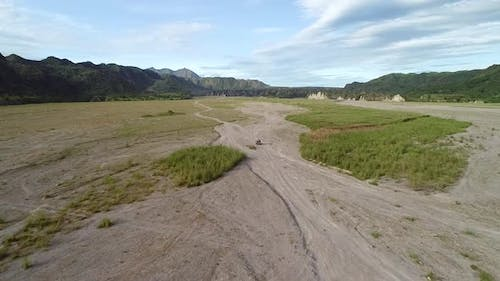 Aerial view following off road jeep in the valley on Tarlac, Philippines.