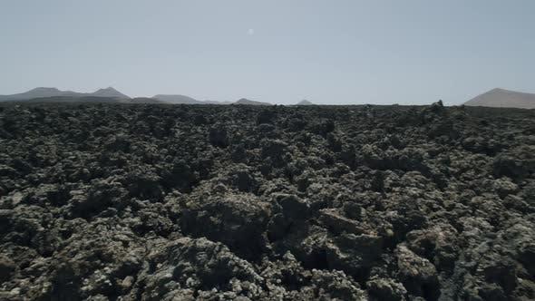 Volcanic rocky soil of Timanfaya National Park