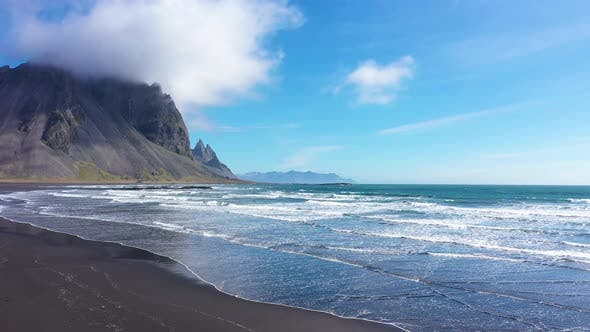 Thumbnail for Flying Over Atlantic Ocean Waves Washing Sandy Beach in Iceland