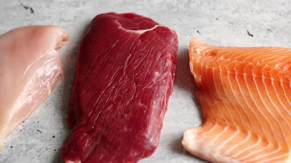 Thumbnail for Fresh Raw Beef Steak, Chicken Breast, and Salmon Fillet