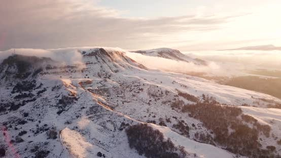 Thumbnail for Great Aerial Landscape Mountain View of the Snowy Massive Rock in Sunlight