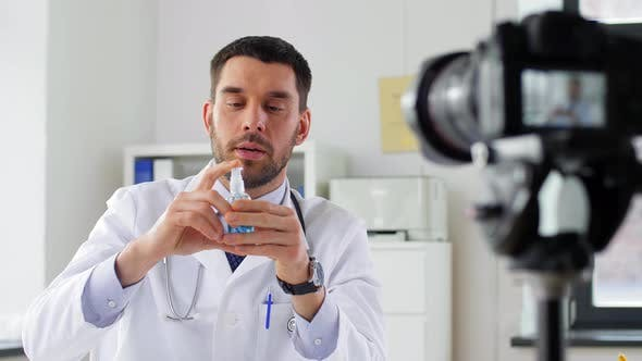 Doctor with Hand Sanitizer Recording Video Blog