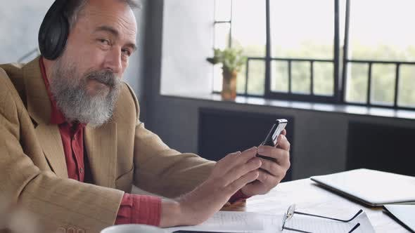 Thumbnail for Stylish Senior Man Using Gadgets