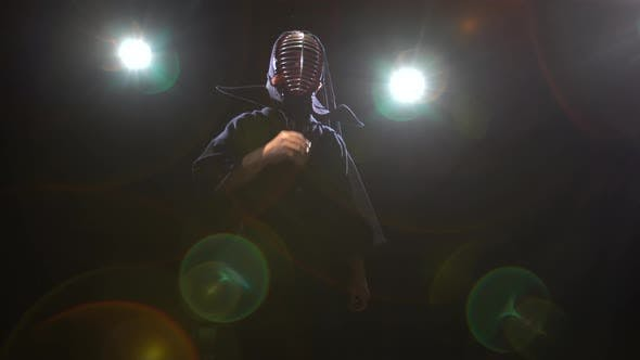 Athletic Kendo Instructor Is Posing for the Camera in Twilight