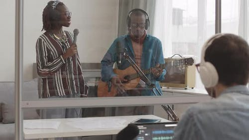 African Musical Band Recording Song in Studio