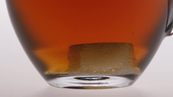 Time Lapse. Sugar Is Dissolved in the Cup of Tea