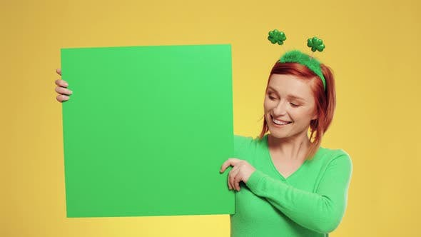 Portrait of woman holding green banner with copy space