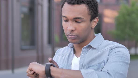 Thumbnail for Young African Man Using Smartwatch