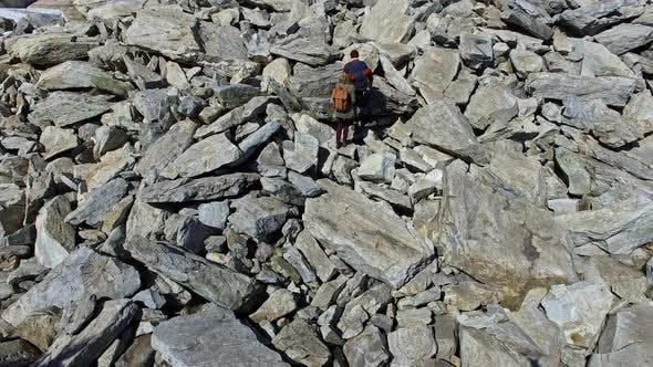 Thumbnail for Aerial of Couple Climbing Rocky Mound