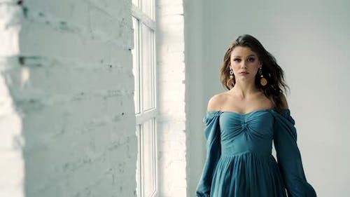 Female Model Walking in Studio Photosession