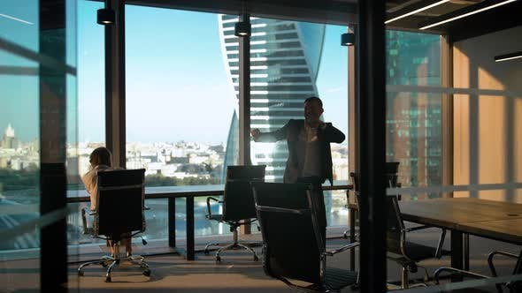 Cover Image for Dancing Male Businessman Silhouette in Modern Business Office with Glass Wall and Door